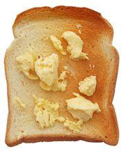 Pão torrado com margarina